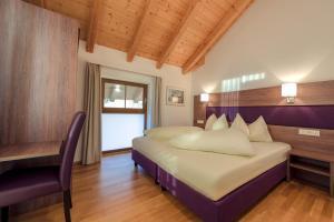 מיטה או מיטות בחדר ב-Aigenberg Appartements