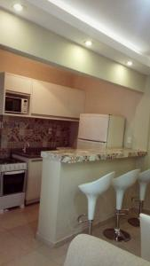 A kitchen or kitchenette at Apartamento Balneário Camboriú