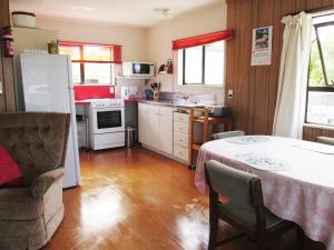A kitchen or kitchenette at Arandar Holiday Home