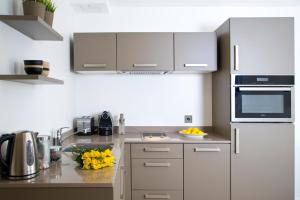 A kitchen or kitchenette at The Rosebery Aparthotel