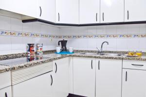 A kitchen or kitchenette at RVHotels Apartamentos Ses Illes