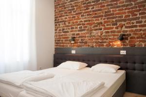 Antim Boutique Apartments tesisinde bir odada yatak veya yataklar