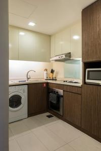 A kitchen or kitchenette at Somerset Liang Court Singapore