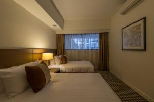 A bed or beds in a room at Somerset Liang Court Singapore