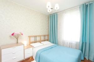A bed or beds in a room at Serviced Apartments Belorusskaya - Moscow