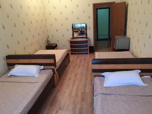 A bed or beds in a room at Tsolmon's Serviced Apartments