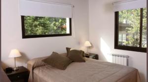 Una cama o camas en una habitación de Complejo Agapanto