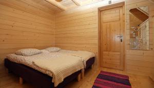 Łóżko lub łóżka w pokoju w obiekcie Dom Numer 3