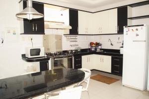 A kitchen or kitchenette at Casa Atalaia