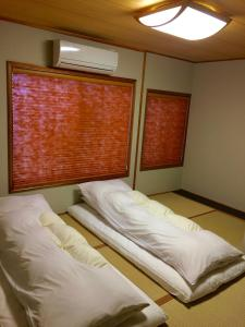 A bed or beds in a room at Uzuki