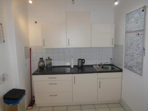 A kitchen or kitchenette at Airport Apartment