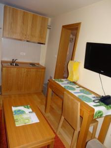 TV in/ali zabaviščno središče v nastanitvi Apartment 116