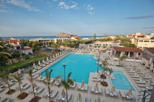 A view of the pool at Porto Platanias Village Resort or nearby