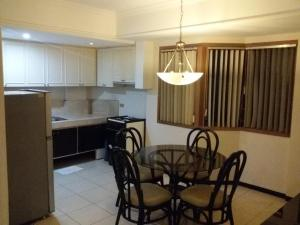 A kitchen or kitchenette at Ralph Anthony Suites