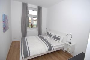 Posteľ alebo postele v izbe v ubytovaní Apartment Na Kopečku