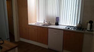 A kitchen or kitchenette at Maisonnette Julienne