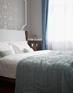 Кровать или кровати в номере Apartments Almandine