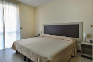 A bed or beds in a room at Residence La Sfera