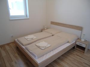Postel nebo postele na pokoji v ubytování Apartments Valentka