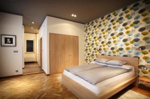 Ein Bett oder Betten in einem Zimmer der Unterkunft Gateway Budapest City Center