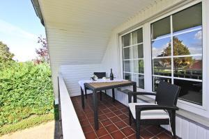 Ein Balkon oder eine Terrasse in der Unterkunft Ferienhaus Ostseerausch