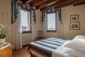 A bed or beds in a room at Residence Palazzo Brando