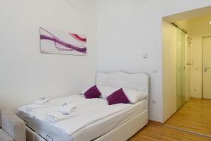 Postel nebo postele na pokoji v ubytování Royal Resort Apartments Belvedere