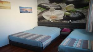 A bed or beds in a room at Casa Home - City Center