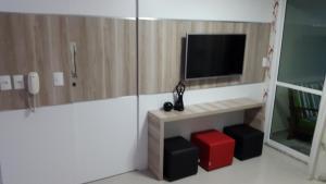 Uma TV ou centro de entretenimento em VG Fun Residence - Fortaleza Flats
