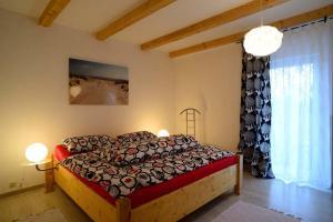 Ein Bett oder Betten in einem Zimmer der Unterkunft Fewo Warder