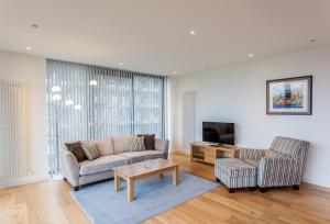 A seating area at My-Quartermile Apartments