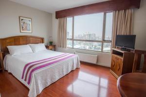 Cama o camas de una habitación en MR Apart Providencia (ex Apart Neruda)