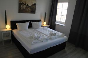 Ein Bett oder Betten in einem Zimmer der Unterkunft Schloß Sonnenstein