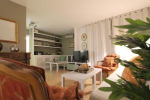 Televizorius ir (arba) pramogų centras apgyvendinimo įstaigoje Apartamento Tosca Deco