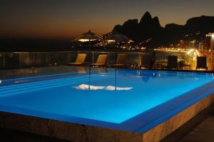 The swimming pool at or near Flat João Lira Leblon