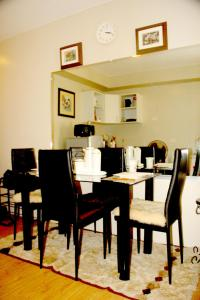A restaurant or other place to eat at Marella Suites
