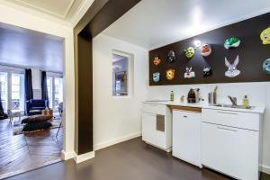 A kitchen or kitchenette at Sweet Inn - Les Halles - Etienne Marcel