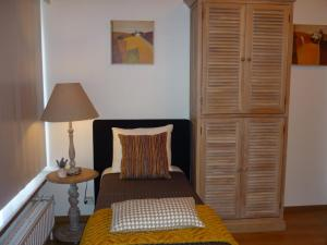 A bed or beds in a room at Apartment Capitalcondos