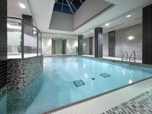 The swimming pool at or near Maplewood Suites - Square One