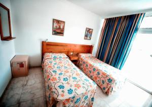 A bed or beds in a room at Apartamentos Montemar
