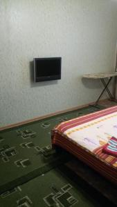 A television and/or entertainment center at Apartamenty Zakirova