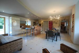 A restaurant or other place to eat at Luxury Farmhouse Brittany