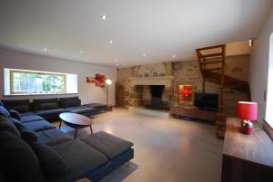 A seating area at Luxury Farmhouse Brittany