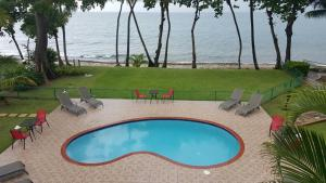 A view of the pool at Tres Palmas Inn and Villas or nearby