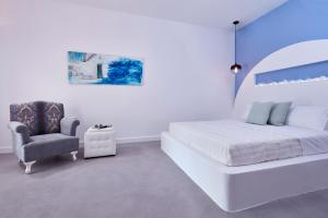 A bed or beds in a room at Orabel Suites Santorini (Adults Only)