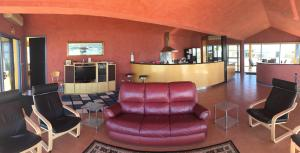 The lounge or bar area at The Penthouse