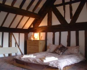 A bed or beds in a room at Horseshoe Pass Holiday Lets