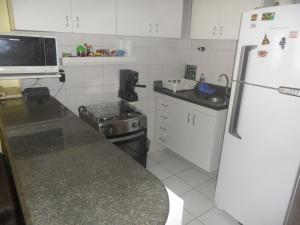 A kitchen or kitchenette at Barra Tropical Residence