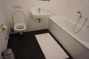 Ein Badezimmer in der Unterkunft Deluxe Apartment Cologne