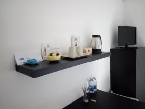 A kitchen or kitchenette at L'Altra Modica Locazione Turistica